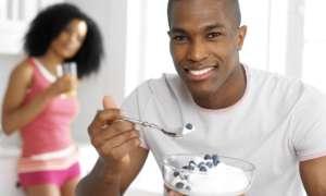 black man eating 300x180 - Fertility Diet