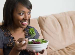 woman eating salad 300x221 - Fertility Diet
