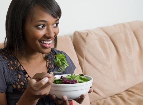 woman eating salad - Home
